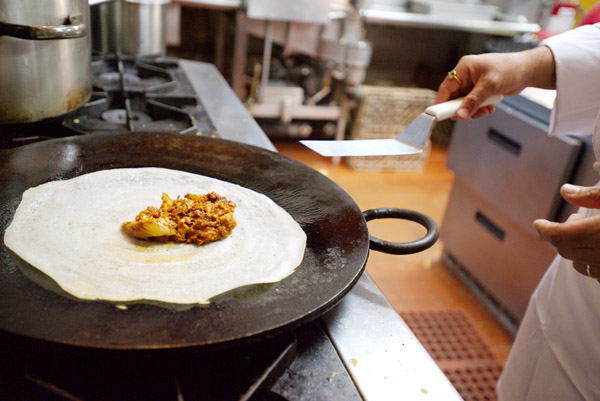 Dosas being made at Junnoon. Photo by Chris Schmauch.