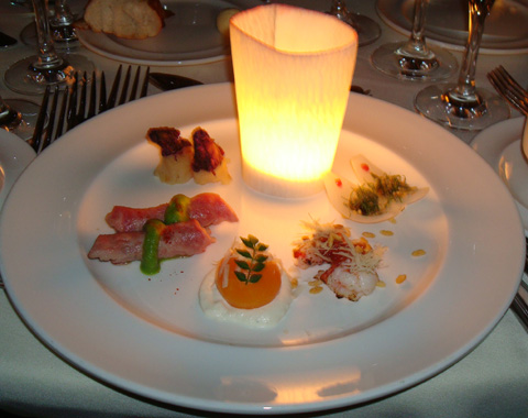 Chef Kunio Tokuoka of Kyoto Kitcho in Japan serves a candle-lit, show-stopping appetizer featuring umami-rich ingredients such as kombu simmered beef, spiny lobster with bonito, and savory egg yolk custard with somked chicken mousse/Parmigiano-Reggiano