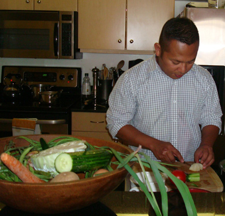 Daniel Sudar cooking in his San Francisco condo