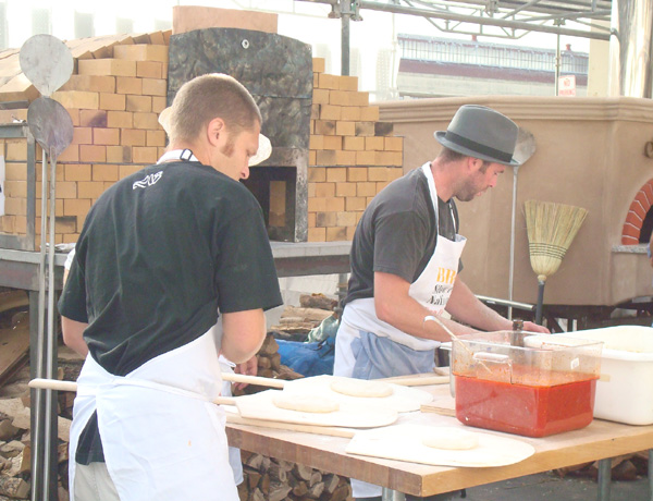 Making pizza margherita at the outdoor breads tasting pavilion.