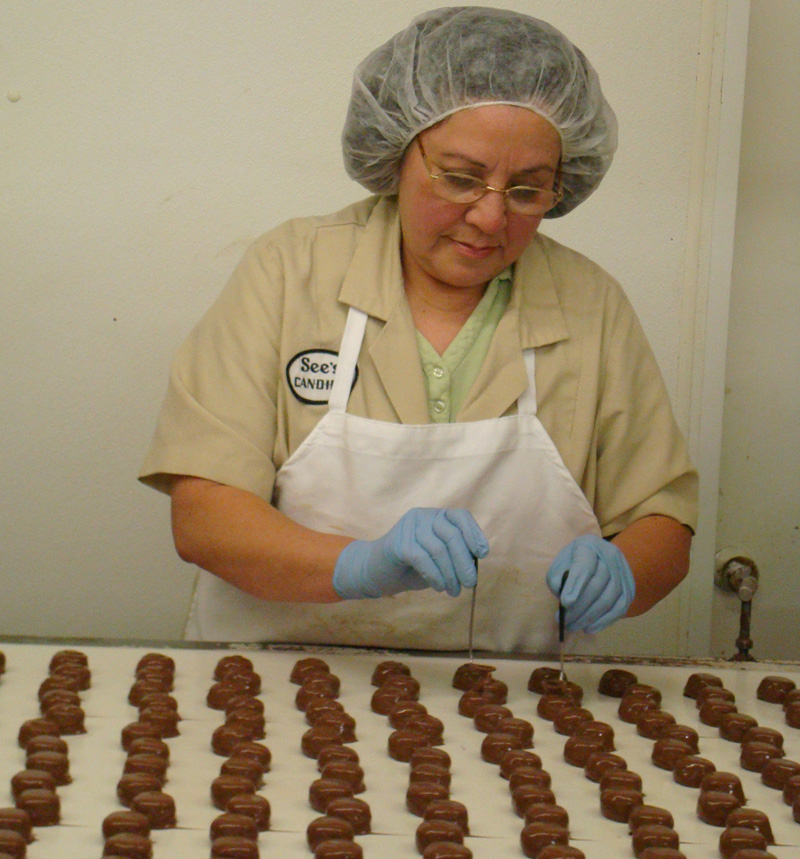 Milk chocolate orange creams get an 'O' put on top of them by hand.