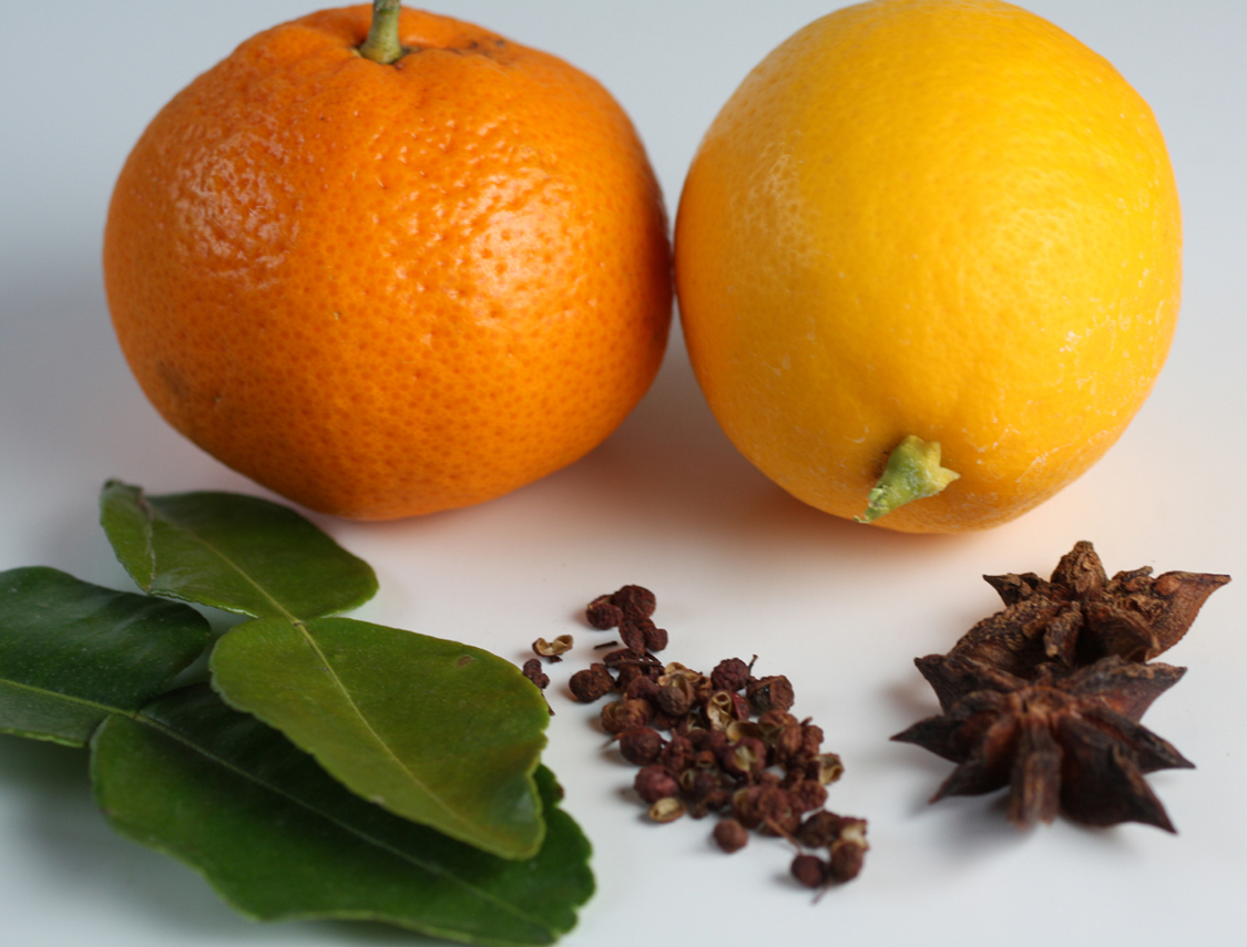 Some of the ingredients for the cocktail above: (back row, left to right) satsuma mandarin and Meyer lemon; (front, left to right) Kaffir lime leaves, Szechuan peppercorns, and star anise.
