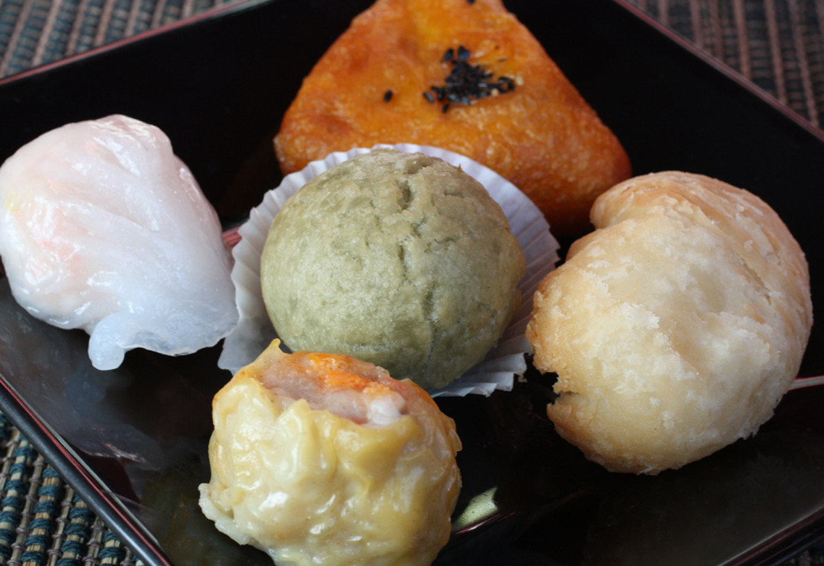 Clockwise from top: Sweet potato puff, durian puff, siu mai, har gau, and (center) sweet green tea dumpling -- all from Dynasty Seafood Restaurant in Cupertino.