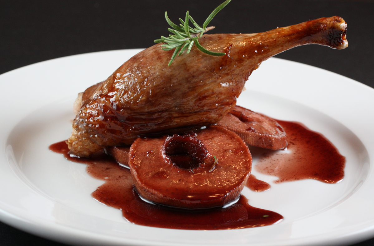 Roasted duck with red wine-braised apples.