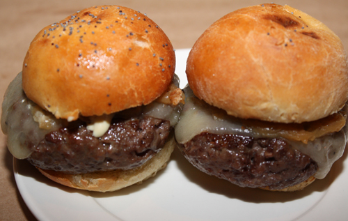 Mini versions of the restaurant's Niman Ranch chuck burgers with fried onions and remoulade were served at Saturday's invitation-only, opening party.