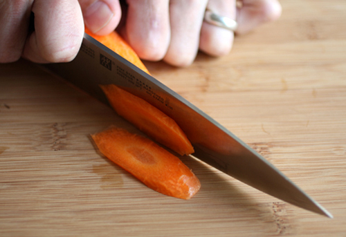 Making slices by cutting at a sharp angle.