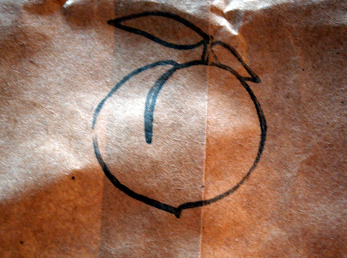 A paper bag with Momofuku's insignia.