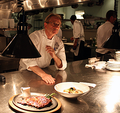 Left Bank Culinary Director Joel Guillon directs the action in the kitchen during a trial run before the opening.