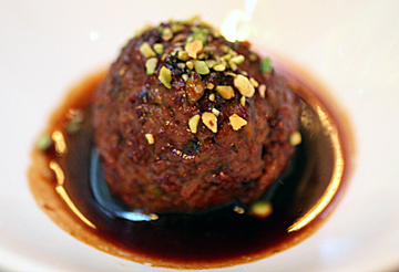 A signature pistachio meatball in a powerful pomegranate sauce.