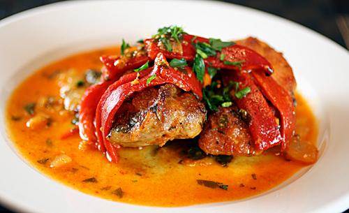 Tender, juicy chicken thighs baked with saffron and piquillo peppers.