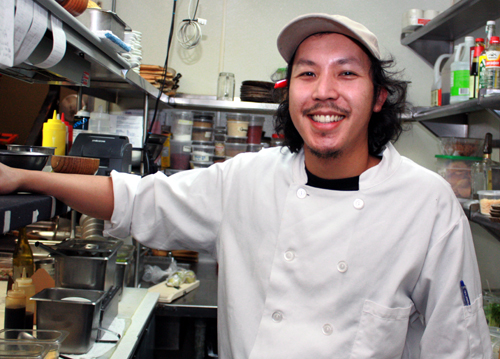 Chef Tim Luym in his shoebox-sized kitchen at Poleng Lounge.