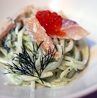 Smoked trout atop noodles made of cucumber.