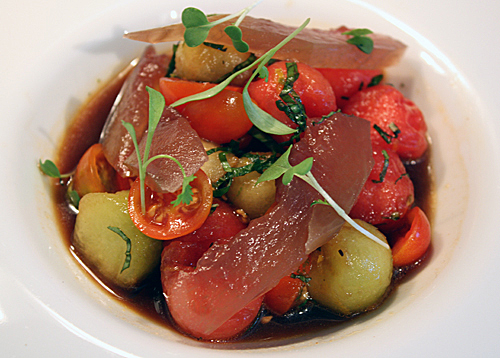 It may look like tuna sashimi, but those are actually slivers of pickled watermelon rind atop that tomato-melon salad.