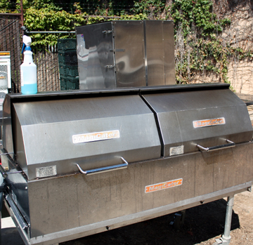 A whole pig has been cooked in the outside grill-smoking area.