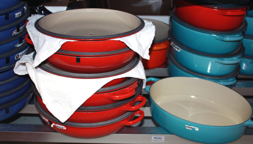 Stacks and stacks of Le Creuset pots at the ready.