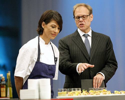 Chef Dominique Crenn gets last minute instructions from commentator Alton Brown. (Photo courtesy of the Food Network)