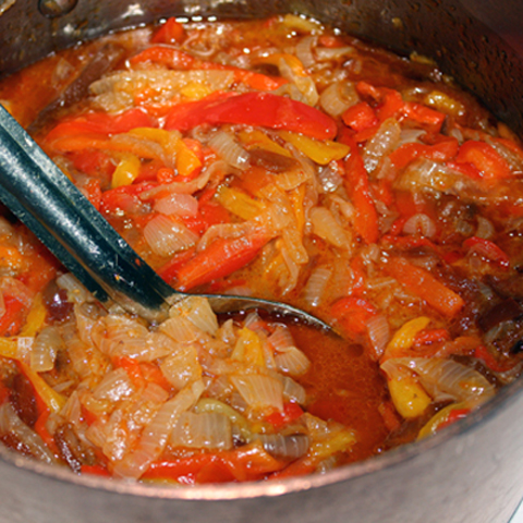 Piperade Basquaise -- a stew of red bell peppers, onions, garlic, coriander, and paprika.