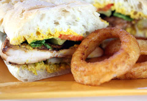Grilled chicken breast sandwich with incredible onion rings.