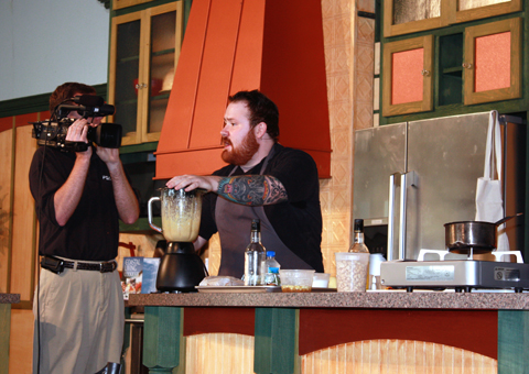 Kevin demonstrating his pork belly dish on stage at the South Carolina food festival.