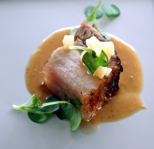 Kevin's grilled pork belly with pickled apples and a zippy peanut sauce.