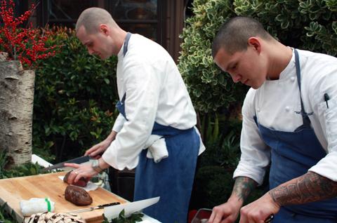 Cooks slicing tender beef tenderloin.'' width=