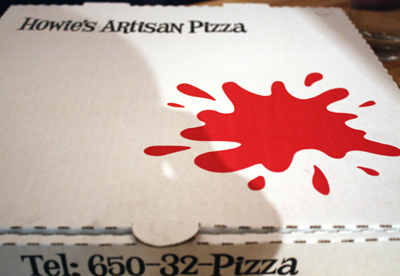 "Pizza box with ""tomato sauce splat'' logo."
