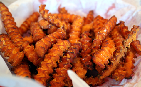 Addicting crinkle-cut sweet potato fries at Acme Burgerhaus.