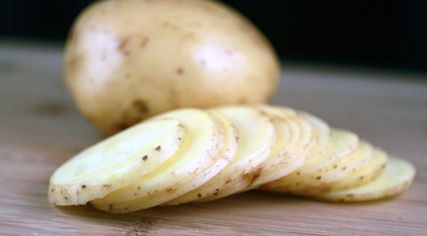 For thicker chips, cut potatoes into 1/8-inch slices like these. For thinner chips, use a mandolin.