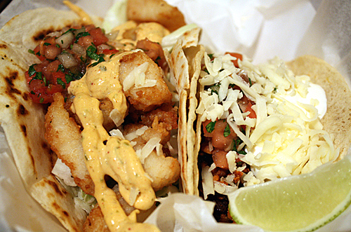 Fish taco on the left; Al pastore taco on the right.