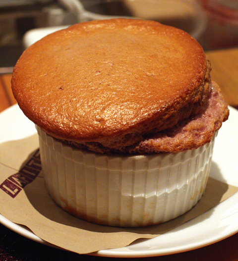 Next, a white chocolate-raspberry souffle that arrived poofy and hot ...