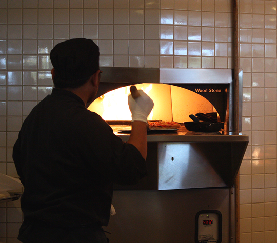 The roaring pizza oven.