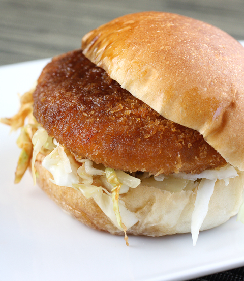 A potato croquette stuffed into a sandwich.