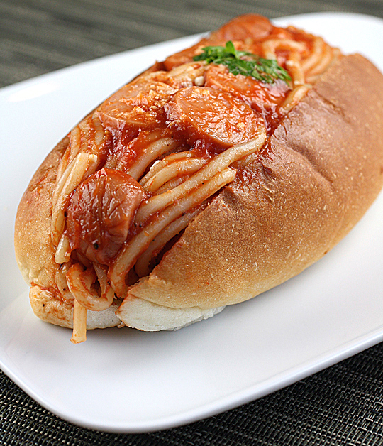 Yes, that is spaghetti in a hot dog bun. Find it only at Clover Bakery.