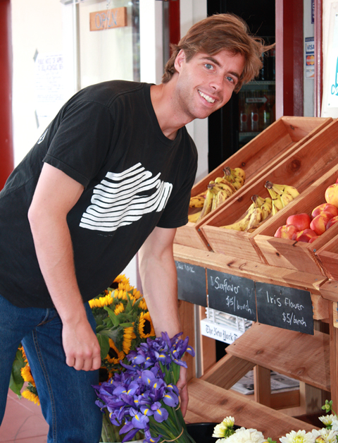 Owner Luke Chappell outside his Luke's Local store at the Caltrain station.