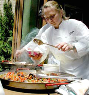 "Maggie Pond of Cesar in Berkeley, making paella at a past ""Spice of Life Festival.'' (Photo courtesy of the North Shattuck Association)"