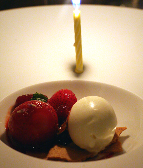 Berries and sorbet -- with a celebratory candle.