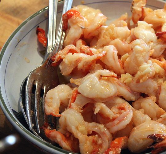 Poached shrimp served chilled.