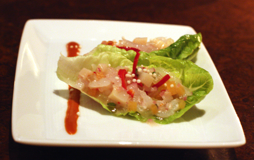 Raw scallops and shrimp with melon and mint in lettuce cups.