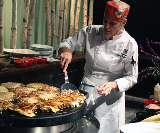 Okonomiyaki -- savory noodle pancakes -- get grilled.