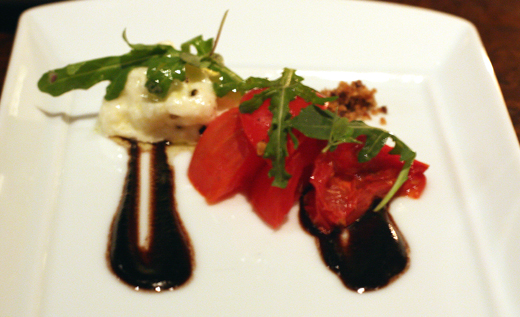 Tomatoes, creamy burrata and a thick, salty black olive vinaigrette.