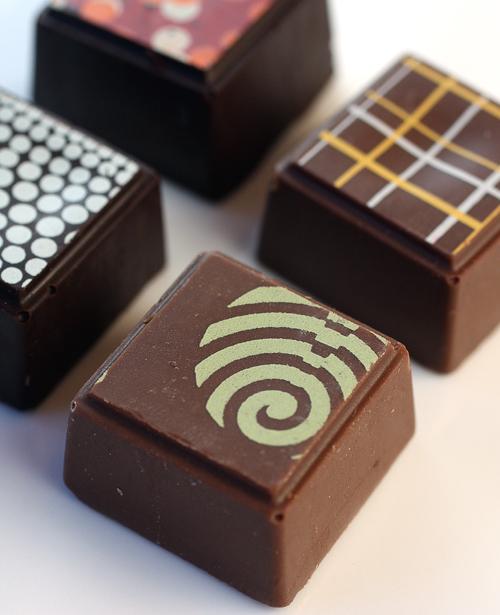 Delysia Chocolatier's handmade, square bonbons.