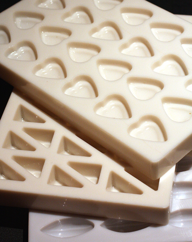 Molds for the chocolates that are made by hand.