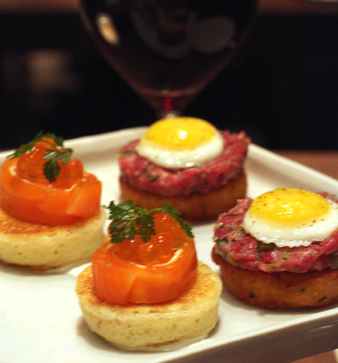Hors d'oeuvres of cured ocean trout and steak tartare.