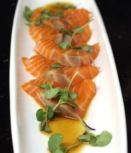 Salmon sashimi get a modern touch with olive oil and ponzu.