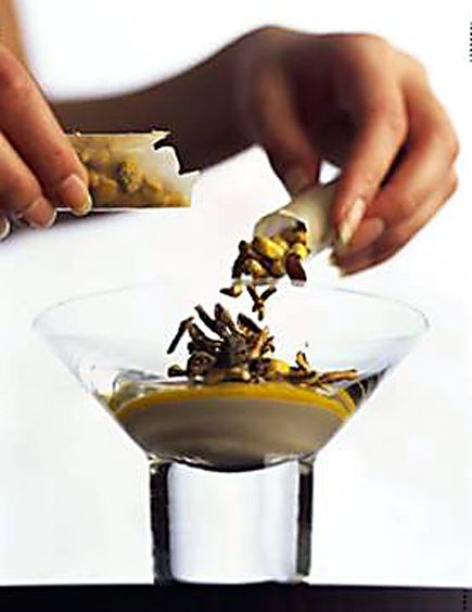 Alinea's hazelnut yogurt, curry saffron, freeze-dried corn in edible tube. (Photo courtesy of Penguin)