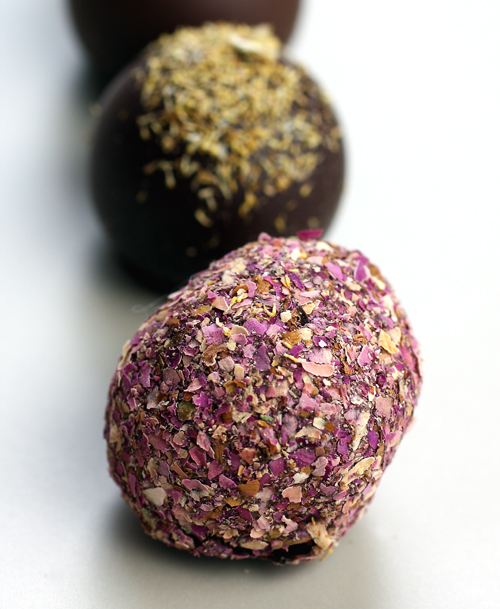 A truffle rolled in dried rose petals.
