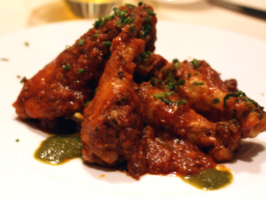 Indian-style chicken wings with fall-off-the-bone tenderness.