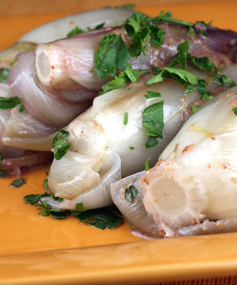 Endive, cooked in chicken stock, then tossed with a mustardy vinaigrette.
