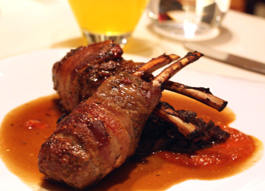 Juicy rack of lamb wrapped in bacon.