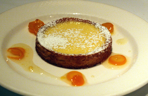 Ricotta cornmeal tart with kumquat compote.